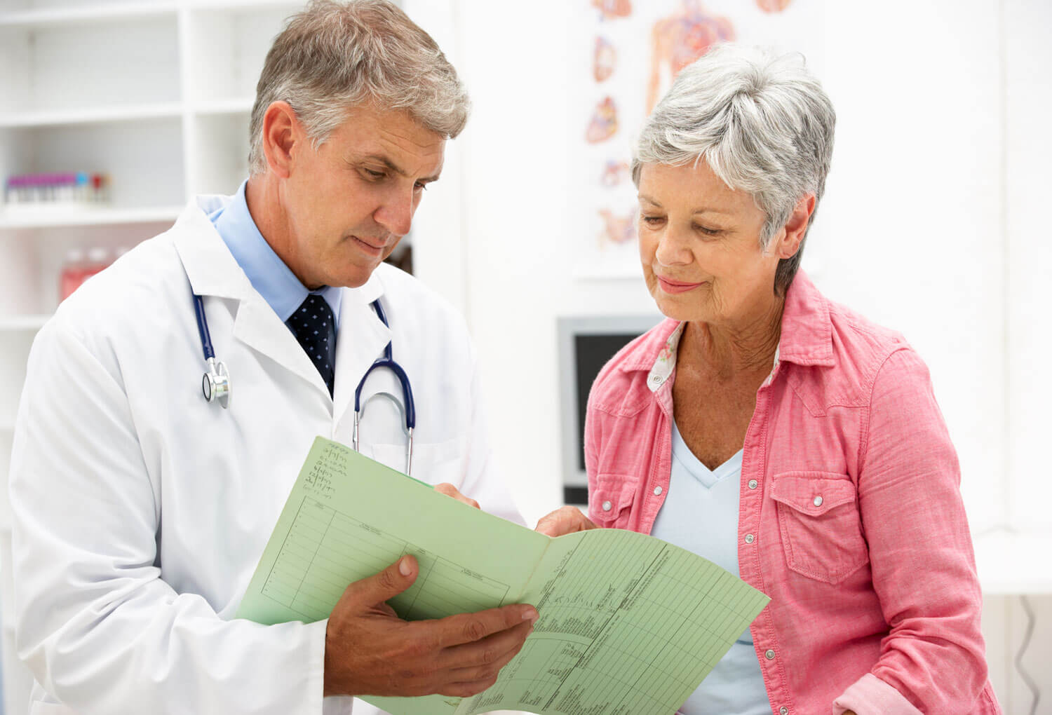 Doctor with patient going over her chart